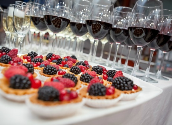 Festive buffet at the event with desert champagne and wine. Soft focus