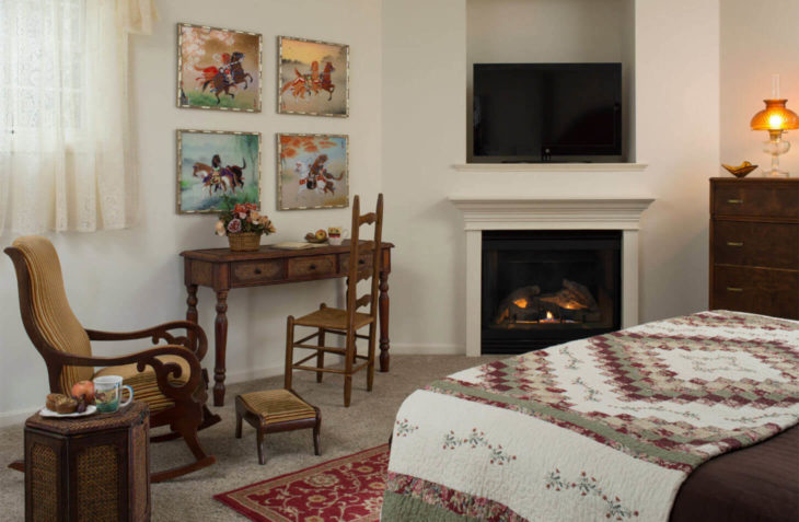 Sitting area by fireplace and paintings
