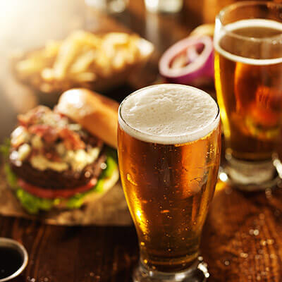 glasses of beer and burgers
