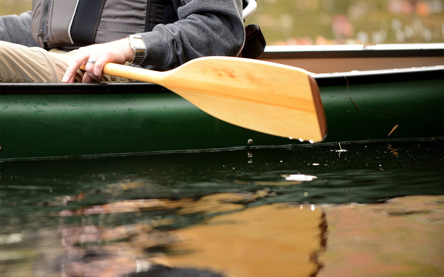 Canoe with oar about to dip into the water