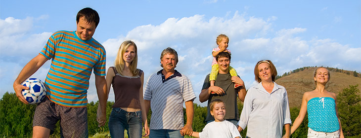 A family together on a walk through a field