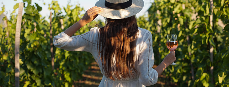Woman walking through vineyard