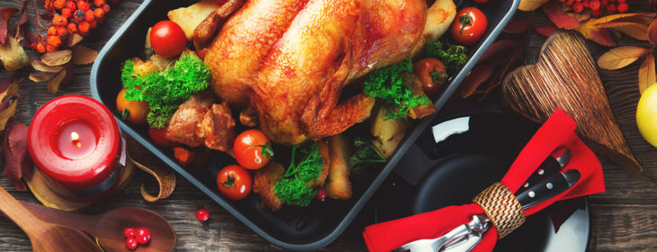 Fresh-cooked thanksgiving turkey on bed of seasonings
