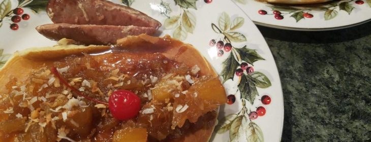 Featured pancake, covered in fruit and marmalade, sit on antique plates ready to be enjoyed