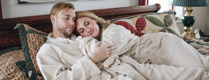 Couple relax together in bed