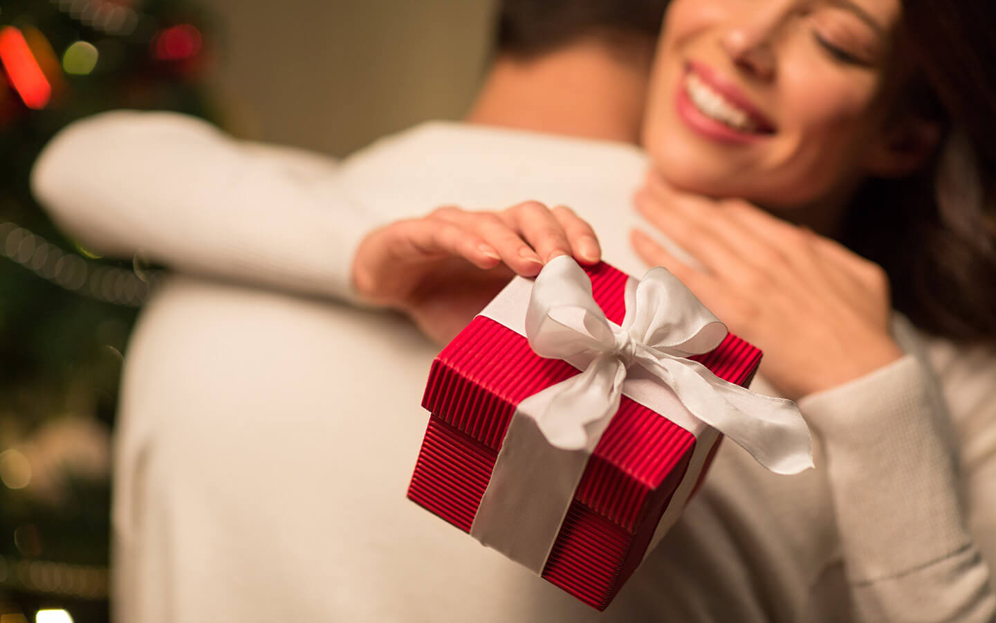 Woman with small holiday gift