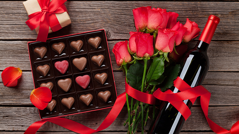 A box of chocolates, roses, and wine for Valentine's Day