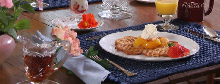 Breakfast table with waffles, parfaits