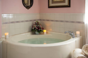 Jetted spa tub with candles