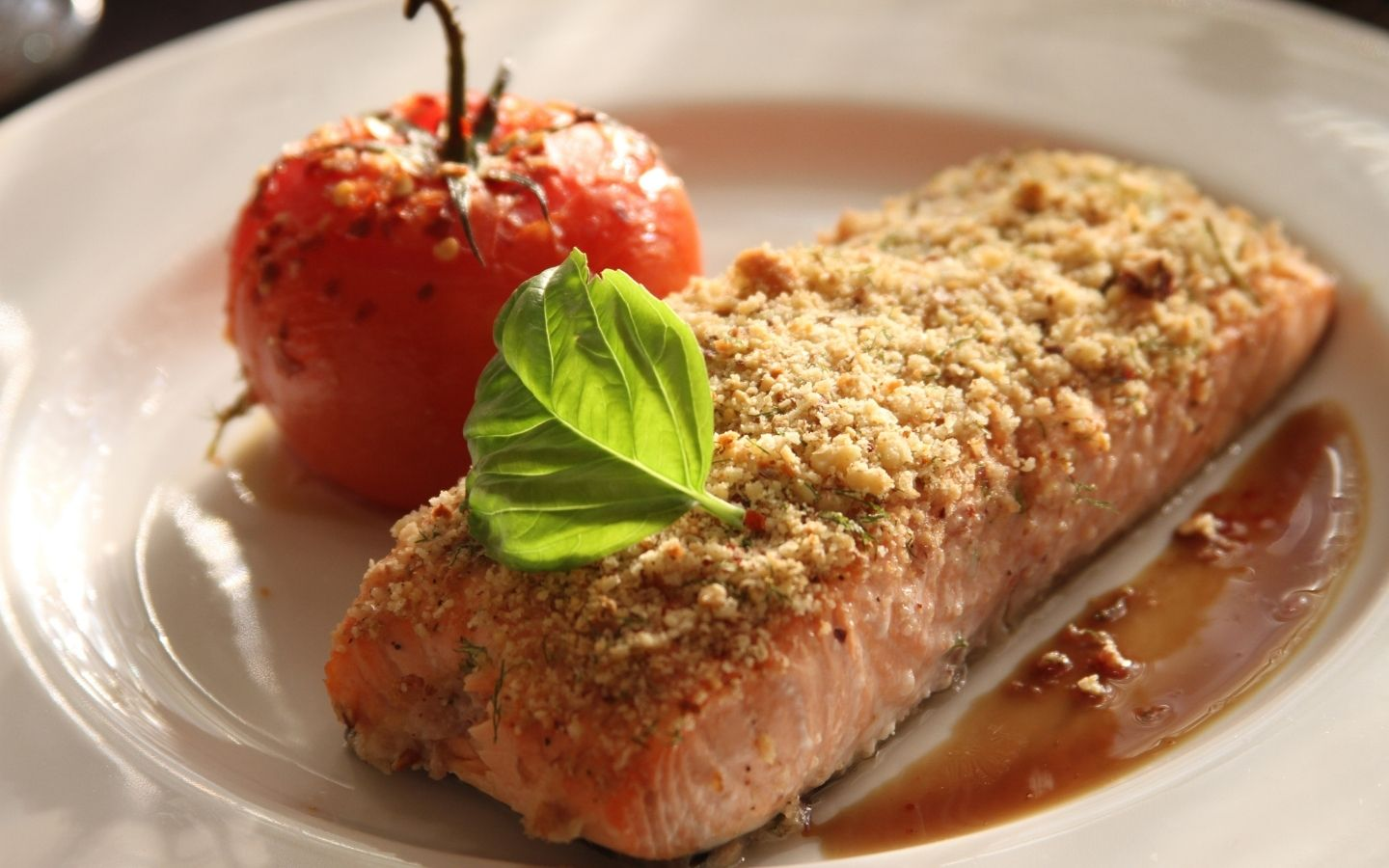 Plate of baked salmon with crispy topping crust and drizzled honey