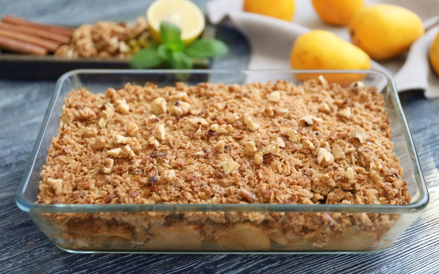 A glass baking dish filled with fresh baked apple crisp